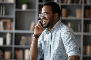 Man smiling while talking on his phone